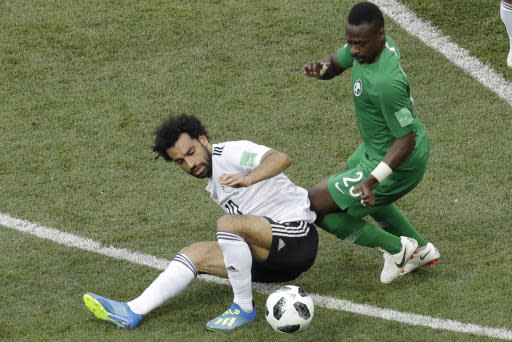 Egypt's Mohamed Salah, with, is challenged by Saudi Arabia's Motaz Hawsawi during their group A match at the 2018 soccer World Cup at the Volgograd Arena in Volgograd, Russia, Monday, June 25, 2018. (AP Photo/Themba Hadebe)