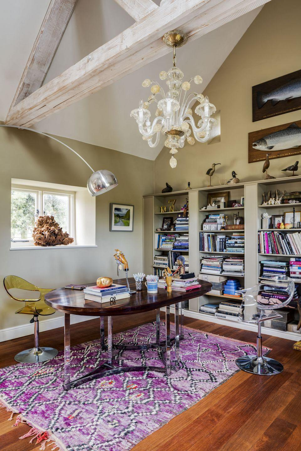 """<p>""""Since lockdown, I have spent most days working from here, surrounded by my favourite books and pieces collected over the years. The 70s Richard Young table I bought from <a href=""""https://www.lescouillesduchien.com/"""" rel=""""nofollow noopener"""" target=""""_blank"""" data-ylk=""""slk:Les Couilles du Chien"""" class=""""link rapid-noclick-resp"""">Les Couilles du Chien</a> was designed as a dining table but makes the perfect desk so I can spread out my reference books, pens, and sketchbooks. This was the site of the old forge, and before we restored it, a giant pair of bellows stood here.""""</p>"""