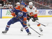 Calgary Flames' James Neal (18) chases Edmonton Oilers' Connor McDavid (97) during second period NHL hockey action in Edmonton, Alberta on Sunday, Dec. 9, 2018. (Jason Franson/The Canadian Press via AP)