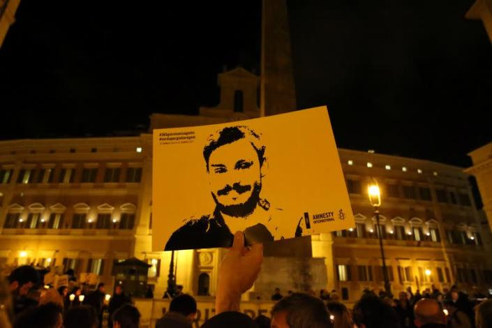 FILE PHOTO: A man holds a placard during a vigil to commemorate Giulio Regeni, who was found murdered in Cairo a year ago, in downtown Rome