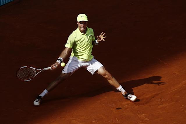 Roberto Bautista from Spain returns the ball during a Madrid Open tennis tournament match against Rafael Nadal from Spain in Madrid, Spain, Saturday, May 10, 2014 . (AP Photo/Daniel Ochoa de Olza)