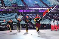<p>Flag bearer Yohan Goncalves Goutt of Democratic Republic of Timor-Leste and his teammates wear red, yellow, and black color-block winter gear during the opening ceremony of the 2018 PyeongChang Games. (Photo: Quinn Rooney/Getty Images) </p>