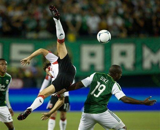 Portland Timbers forward Bright Dike (19) gets called for a foul after DC United defender Dejan Jakovic (5) goes down awkwardly as they battle for a loose ball during an MLS soccer match in Portland, Ore, Saturday Sept. 29, 2012. (AP Photo/ The Oregonian, Doug Beghtel)