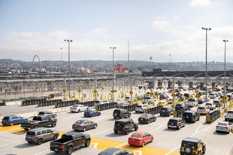 Cars pass from the US into Mexico at the border crossing in San Ysidro, California on May 31, 2019; cross-border business would be hit hard by new tariffs threatened by US President Donald Trump (AFP Photo/ARIANA DREHSLER)