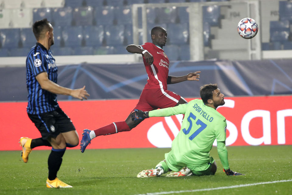 Liverpool's Sadio Mane, center, scores against Atalanta during the Champions League, group D soccer match between Atalanta and Liverpool, at the Gewiss Stadium in Bergamo, Italy, Tuesday, Nov. 3, 2020. (AP Photo/Luca Bruno)