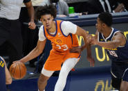 Phoenix Suns forward Cameron Johnson looks to pass the ball as Denver Nuggets guard PJ Dozier defends during the first half of an NBA basketball game Friday, Jan. 1, 2021, in Denver. (AP Photo/David Zalubowski)