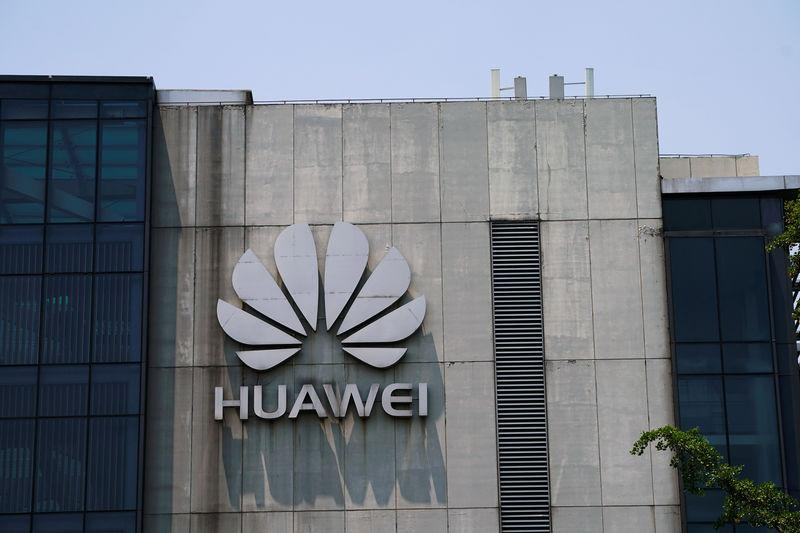 FILE PHOTO: A Huawei company logo is seen at Huawei's Shanghai Research Center in Shanghai