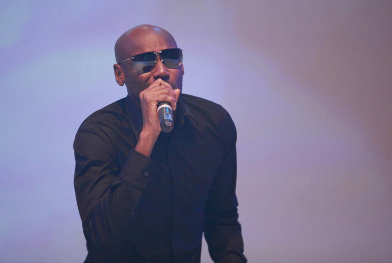 """In this photo taken Sunday June 30, 2013, hip hop artist 2Face Idibia performs during the launch of EbonyLife TV, Africa's first global black entertainment network in Lagos, Nigeria. Mo Abudu, who could be considered Africa's Oprah Winfrey, is launching an entertainment network that will be beamed into nearly every country on the continent with programs showcasing its burgeoning middle class. Mosunmola """"Mo"""" Abudu wants EbonyLife TV to inspire Africans and the rest of the world, and change how viewers perceive the continent. (AP Photo/Sunday Alamba)"""