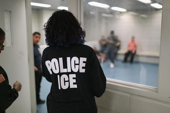 Undocumented immigrants wait in a holding cell at a U.S. Immigration and Customs Enforcement processing center in lower Manhattan. (Photo: John Moore/Getty Images)