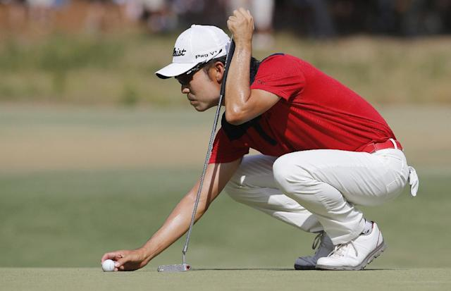 Kevin Na lines up his putt on the seventh hole during the third round of the U.S. Open golf tournament in Pinehurst, N.C., Saturday, June 14, 2014. (AP Photo/Matt York)