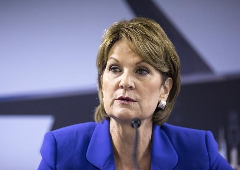 Chief Executive Officer of Lockheed Martin Corp Hewson speaks to journalists at a news conference at the 2014 Farnborough International Airshow in Farnborough
