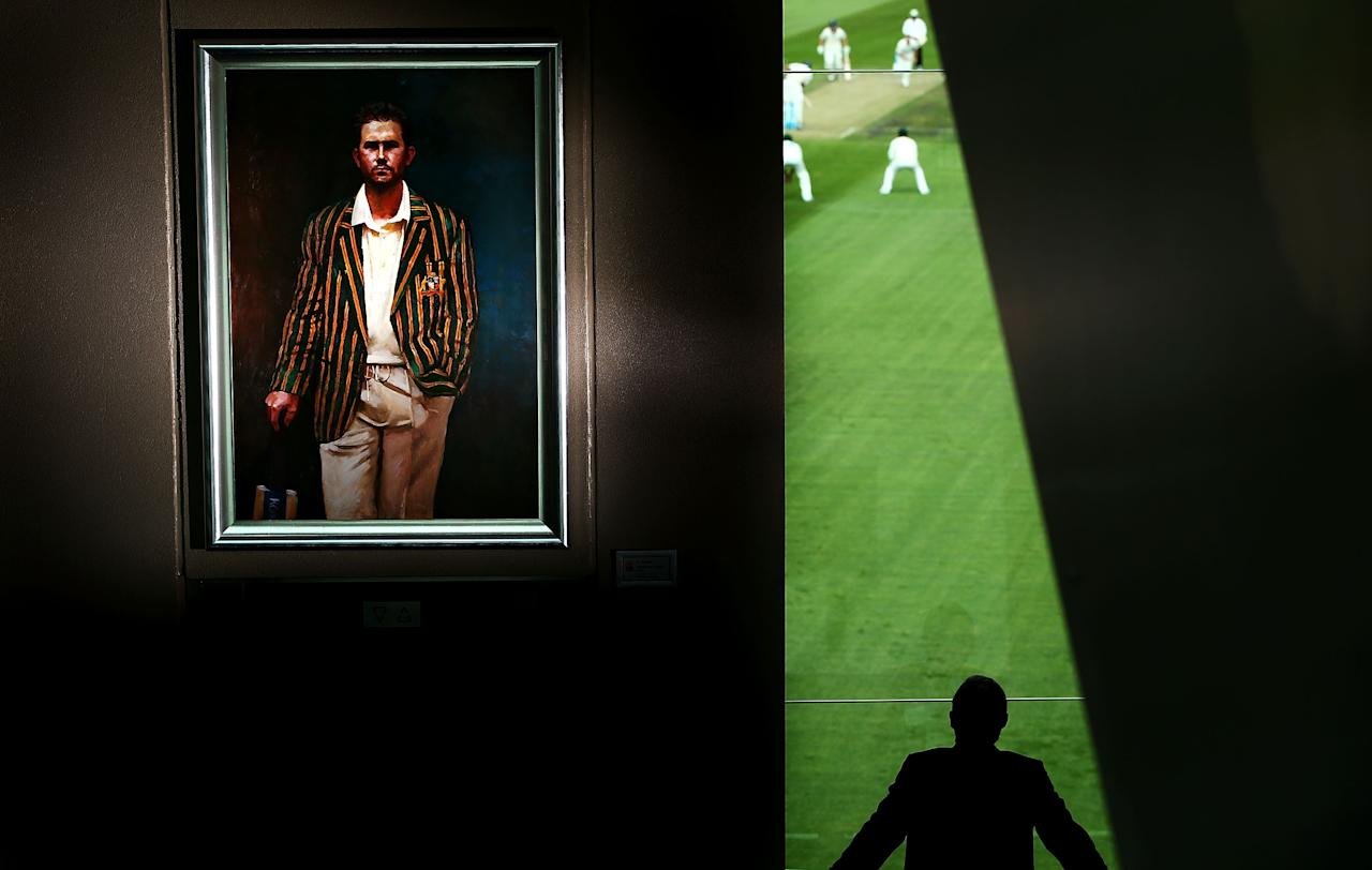 HOBART, AUSTRALIA - MARCH 15: A portrait of Ricky Ponting is displayed in the foyer of the Tasmanian Cricket Museum as a man watches play during day two of the Sheffield Shield match between the Tasmania Tigers and the Victoria Bushrangers at Blundstone Arena on March 15, 2013 in Hobart, Australia.  (Photo by Mark Nolan/Getty Images)