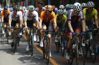 Maximilian Schachmann, from left, of Germany, Nikias Arndt, of Germany, Tom Dumoulin, of the Netherlands, Richie Porte, of Australia and Luke Durbridge, of Australia, compete in the men's cycling road race at the 2020 Summer Olympics, Saturday, July 24, 2021, in Oyama, Japan. (Tim de Waele/Pool Photo via AP)