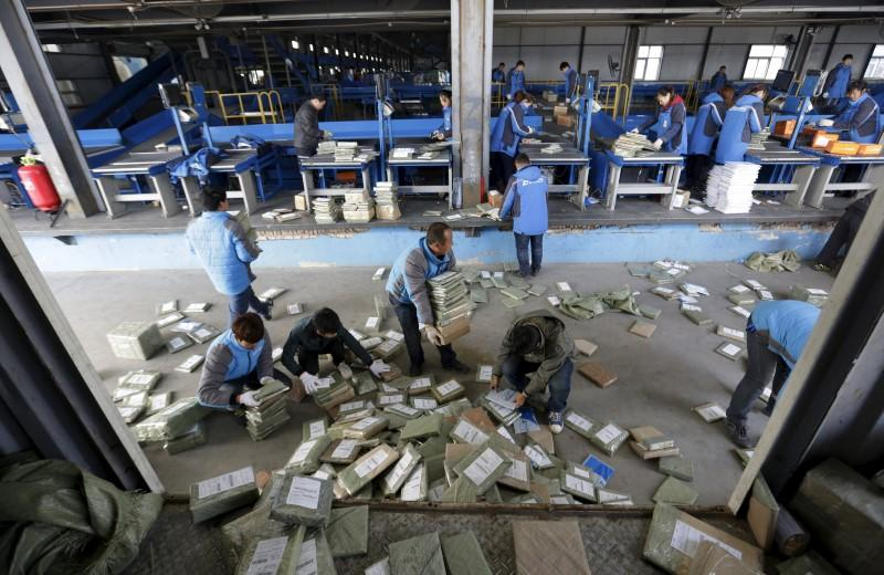 Employees work at a sorting centre of Zhongtong (ZTO) Express ahead of the Singles Day shopping festival, Chaoyang District, Beijing