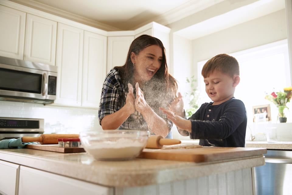 Felicia, mom of two boys, has fun in the kitchen with her older son. (Photo: WW)