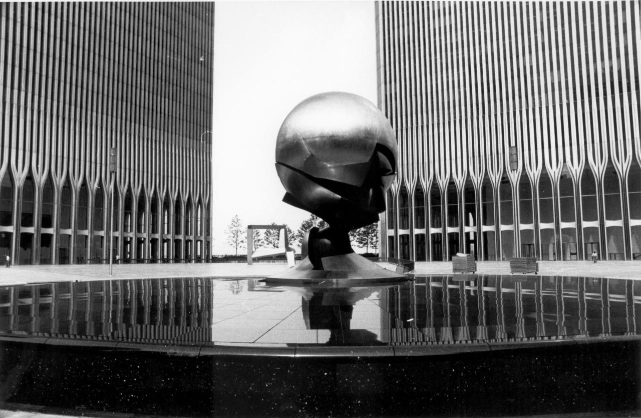 FILE - This May 24, 1977 file photo shows a sculpture by German artist Fritz Koening at the World Trade Center in New York. The 25-ton, bronze sphere ripped open by the collapsing towers is returning to a spot overlooking the rebuilt site. The Port Authority of New York and New Jersey on Thursday July 21, 2016, approved plans to move the Koenig Sphere from its temporary place in Battery Park at Manhattan's southern tip. The sculpture will grace the new Liberty Park overlooking the 9/11 memorial. No date has yet been set for the move. (AP Photo/File)