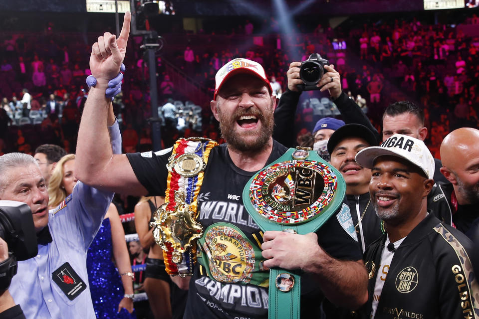 Tyson Fury, of England, celebrates after defeating Deontay Wilder in a heavyweight championship boxing match Saturday, Oct. 9, 2021, in Las Vegas. (AP Photo/Chase Stevens)