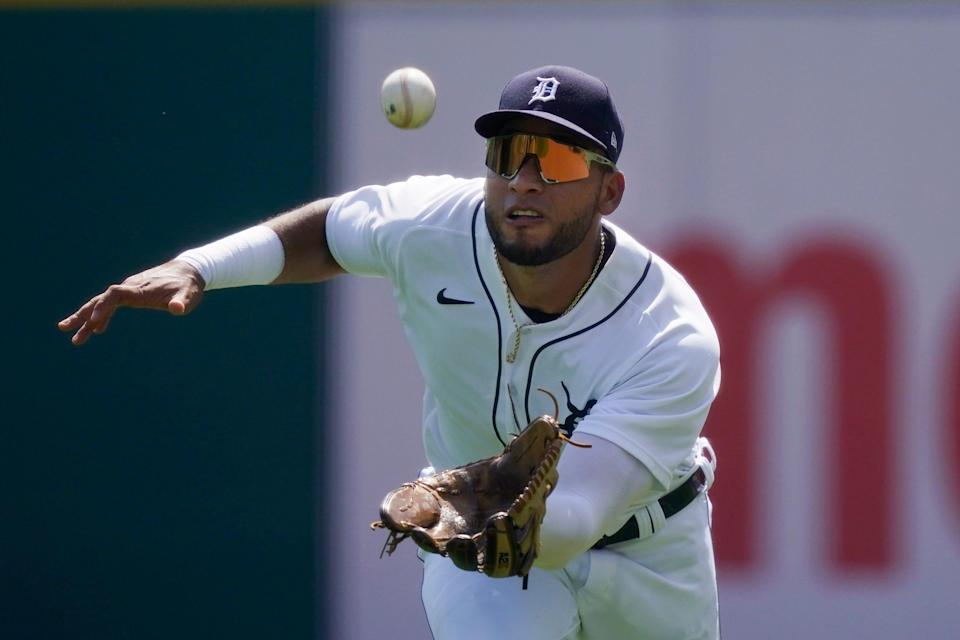 Detroit Tigers right fielder Victor Reyes misplays the single by Toronto Blue Jays' Teoscar Hernandez but is able to recover and throw out Vladimir Guerrero Jr. at second on a fielder's choice during the first inning of a baseball game, Sunday, Aug. 29, 2021, in Detroit.