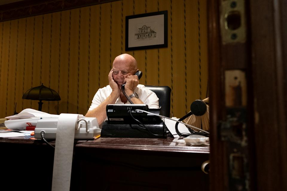 Mark Martin speaks on the phone inside the Brookville Hotel, closed permanently due to the coronavirus disease (COVID-19) pandemic, in Abilene, Kansas, U.S. October 10, 2020. Picture taken October 10, 2020.  REUTERS/Arin Yoon