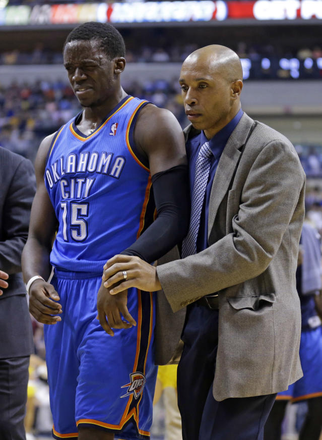 Oklahoma City Thunder guard Reggie Jackson, left, is helped to the locker room after a collision in the second half of an NBA basketball game against the Indiana Pacers in Indianapolis, Sunday, April 13, 2014. The Pacers defeated the Thunder 102-97. (AP Photo/Michael Conroy)