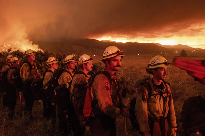 Firefighters from Cal Fire's Placerville station monitor the Sugar Fire, part of the Beckwourth Complex Fire, in Doyle, Calif., on Friday, July 9, 2021. (AP Photo/Noah Berger)