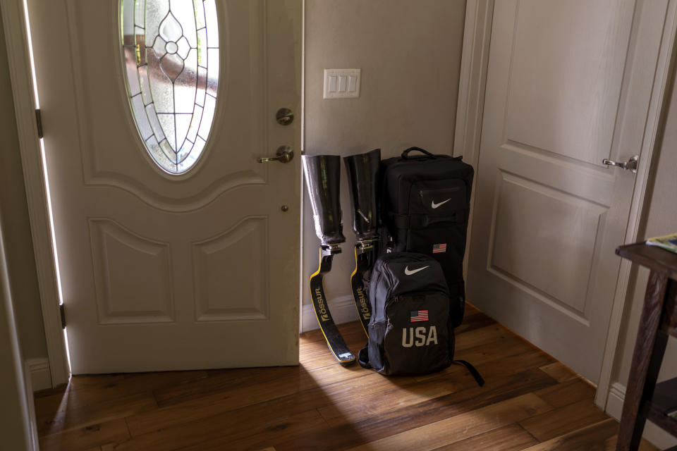 Luis Puertas' suitcases and a pair of prosthetic blades sit by his door in Orlando, Fla., on Monday, Aug. 9, 2021, as he prepares to travel to the Tokyo Paralympics Games. (AP Photo/Emilio Morenatti)