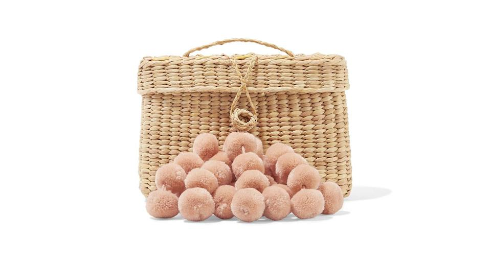 """<p>This pom pom adorned straw bag is right at the top of our wish list. <a rel=""""nofollow noopener"""" href=""""https://www.net-a-porter.com/gb/en/product/1011679/nannacay/baby-roge-pompom-embellished-woven-raffia-tote"""" target=""""_blank"""" data-ylk=""""slk:Buy here."""" class=""""link rapid-noclick-resp""""><em>Buy here.</em></a> </p>"""