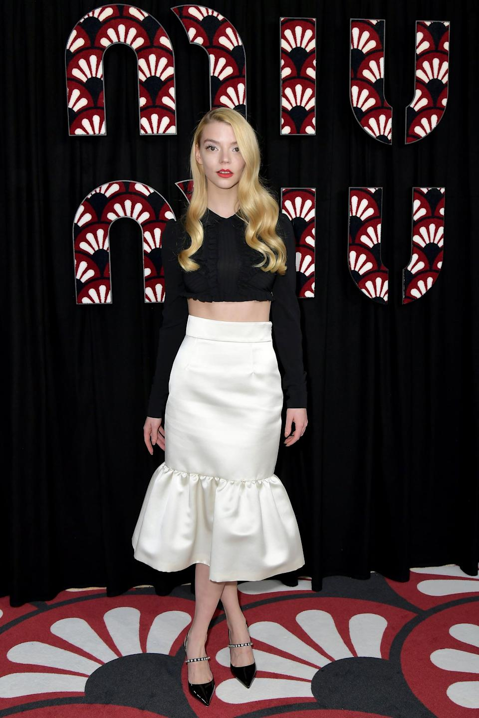 """<p>Anya attended the <a href=""""https://www.popsugar.com/fashion/miu-miu-fall-2020-collection-47274991"""" class=""""link rapid-noclick-resp"""" rel=""""nofollow noopener"""" target=""""_blank"""" data-ylk=""""slk:Miu Miu show at Paris Fashion Week"""">Miu Miu show at Paris Fashion Week</a> wearing separates from the label in March 2020.</p>"""
