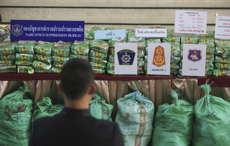 Reporters view packages of methamphetamines on a table during a press conference at Narcotics Suppression Bureau Bangkok, Thailand, Monday, July 15, 2019. Police said they seized 459 kilograms (1,012 pounds) of crystal methamphetamine last week that they suspect originated from neighboring Myanmar. The drugs were found in the back of a pickup truck covered under a large green canvas. (AP Photo)