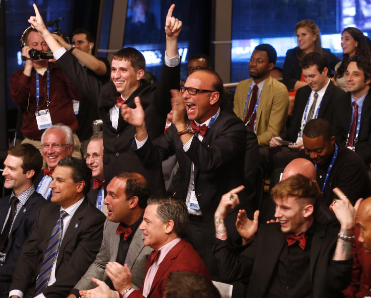 Members of the Cleveland Cavaliers delegation celebrate after winning the NBA basketball draft lottery, Tuesday, May 21, 2013 in New York. (AP Photo/Jason DeCrow)