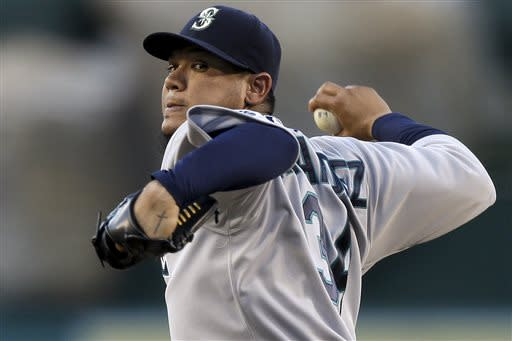 Seattle Mariners starting pitcher Felix Hernandez throw to the Los Angeles Angels during the first inning of a baseball game in Anaheim, Calif., Thursday, June 20, 2013. (AP Photo/Chris Carlson)