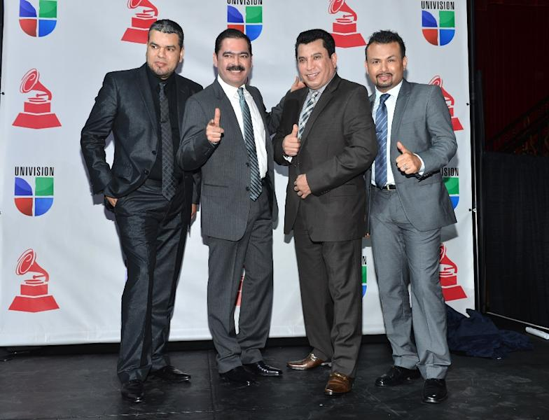 "Los Tucanes De Tijuana, posing during the 2012 Latin Grammy nominations in Los Angeles, California, are masters of a hugely popular but highly controversial sub-genre, the ""narcocorrido"" -- songs that celebrate the exploits of Mexico's drug traffickers (AFP Photo/Alberto E. Rodriguez)"