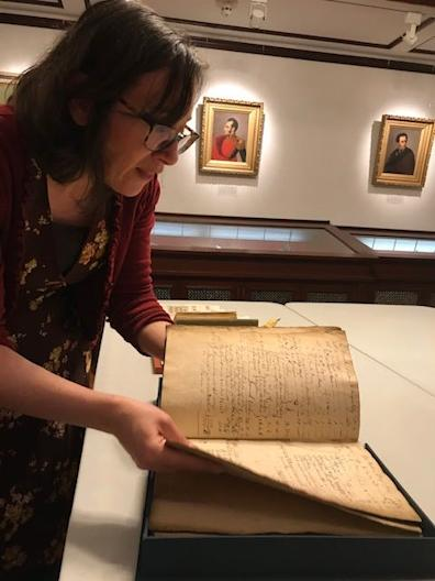 Kimberly Nusco, a librarian at the John Carter Brown Library at Brown University, showed the 1764 accounting book for the Sally, a slave ship that left Providence, Rhode Island and headed toward the West Coast of Africa.