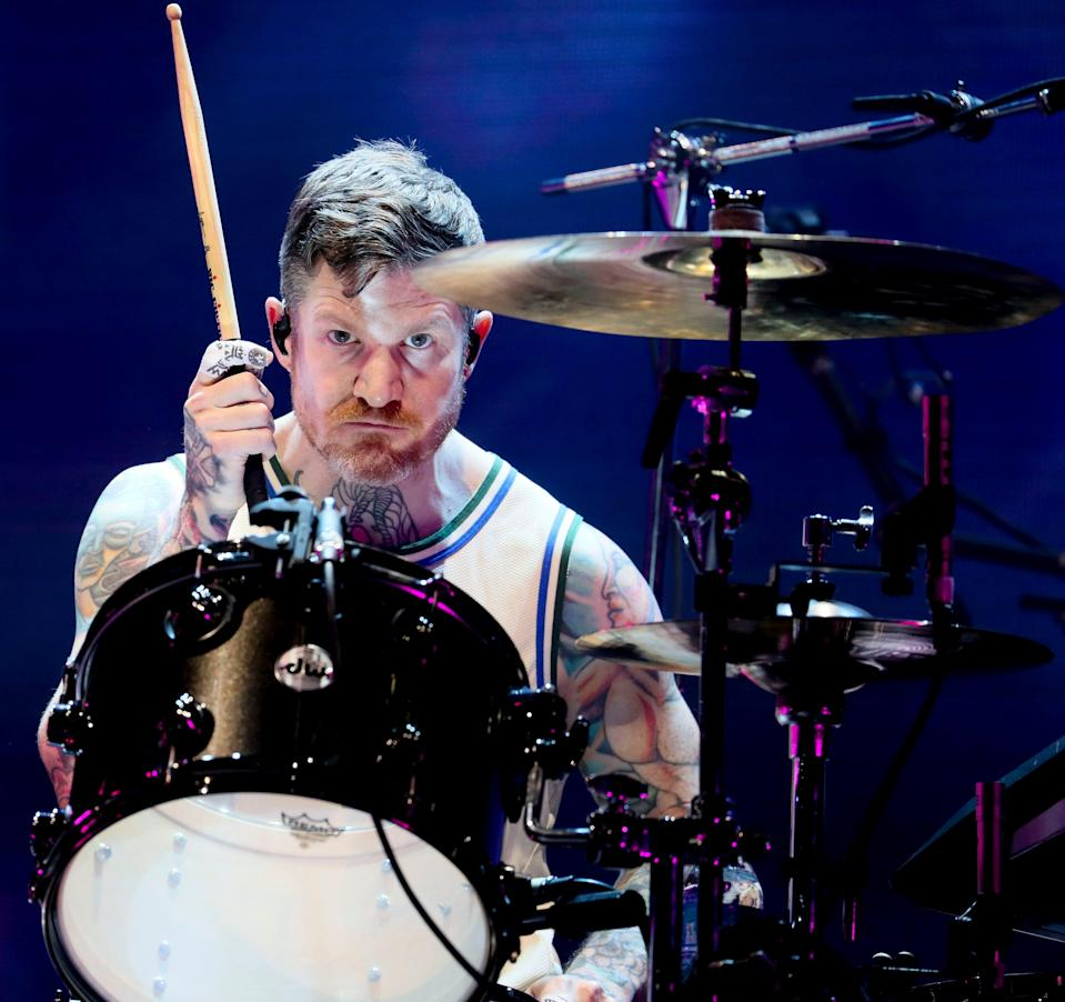 Fall Out Boy drummer Andrew Hurley, who's from Menomonee Falls and wearing a Giannis Antetokounmpo jersey, performs at the American Family Insurance Amphitheater on Sept. 1, 2021, as part of the Hella Mega Tour.