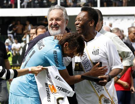 Soccer legend Pele is greeted by Santos' Neymar as Santos FC President Ribeiro looks on during a ceremony in Santos to celebrate the 100th anniversary of Brazilian soccer club Santos