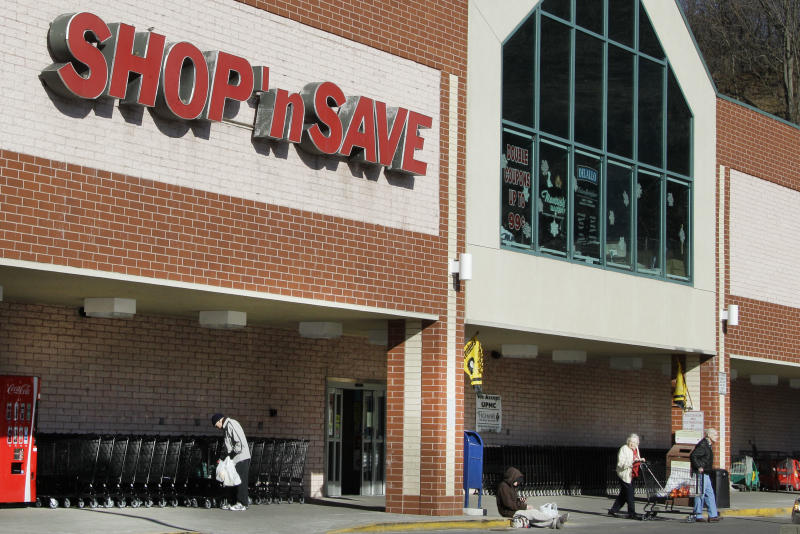 FILE  - In this Jan. 9, 2012 file photo, customers exit a Shop' Save grocery store in Mount Lebanon, Pa.  Supervalu Inc. said Tuesday, April 10, 2012 that it swung to a loss in the fourth quarter as a result of impairment charges and costs related to store closures and layoffs. But excluding those items, the company's results beat Wall Street's expectations, sending its shares up 15 percent.   (AP Photo/Gene J. Puskar, File)