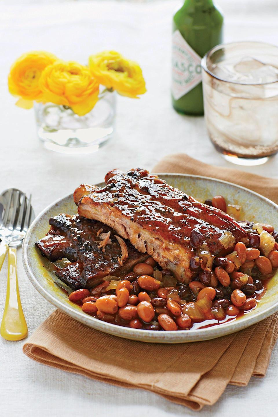 """<p><strong>Recipe:</strong> <a href=""""http://www.myrecipes.com/recipe/spicy-sweet-ribs-beans-10000000392326/"""" rel=""""nofollow noopener"""" target=""""_blank"""" data-ylk=""""slk:Spicy-Sweet Ribs and Beans"""" class=""""link rapid-noclick-resp""""><strong>Spicy-Sweet Ribs and Beans</strong></a></p> <p>Slow cookers don't brown food, so here we broil the ribs for extra flavor before adding them to the pot. Serve with cornbread and a simple green salad with creamy Italian or ranch dressing.</p>"""