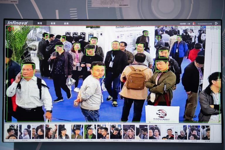 Facial-recognition screens analysing candid shots of conference attendees were scattered around the exhibition hall