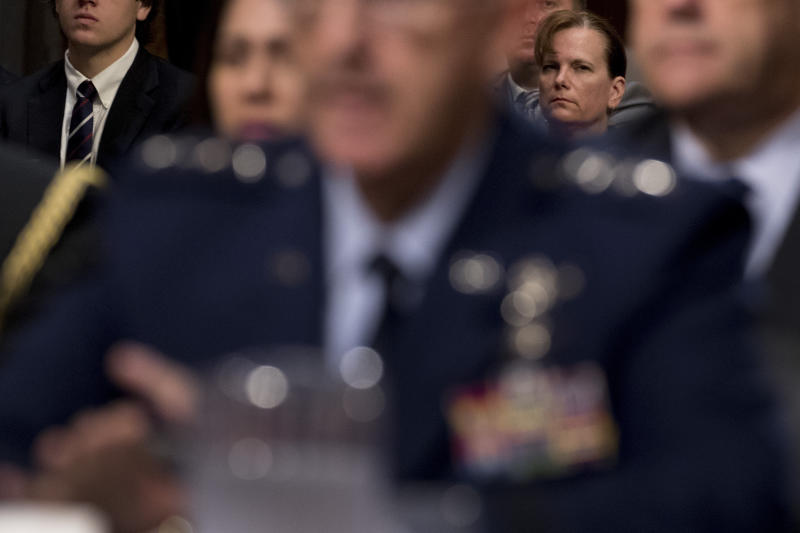 Former aide Army Col. Kathryn Spletstoser, right, sits in the audience as Gen. John Hyten, foreground, appears before a Senate Armed Services Committee on Capitol Hill in Washington, Tuesday, July 30, 2019, for his confirmation hearing to be Vice Chairman of the Joint Chiefs of Staff. (AP Photo/Andrew Harnik)