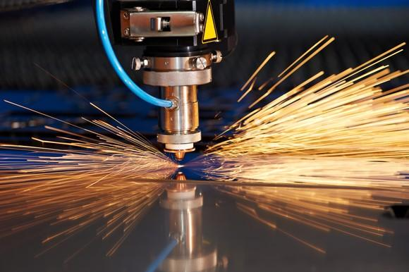 Laser cutting through metal during manufacturing