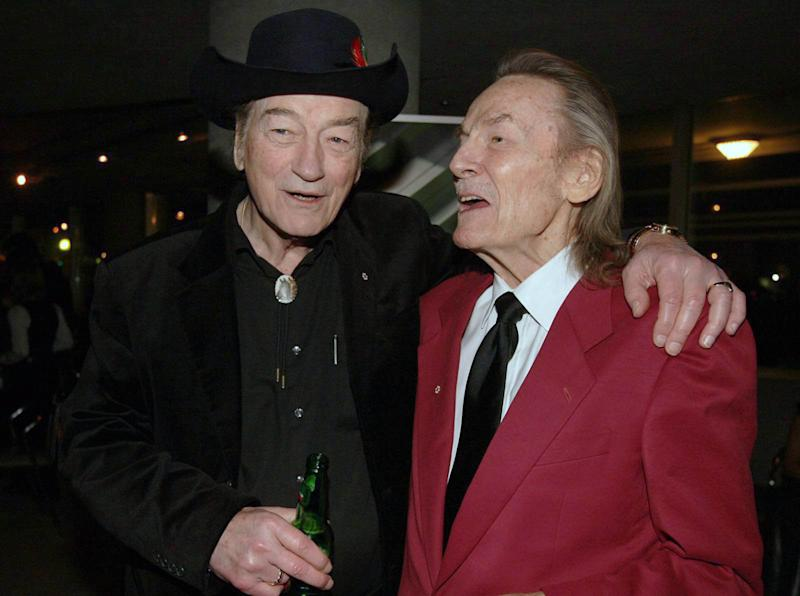 FILE - In this Nov. 23, 2009 file photo, Canadian music legends Stompin' Tom Connors, left, and Gordon Lightfoot pose for a photo prior to the 20th Annual SOCAN Awards gala in Toronto. Canadian country-folk singer Stompin' Tom Connors, whose toe-tapping musical spirit and fierce patriotism established him as one of Canada's biggest cultural icons, has died, his promoter said Wednesday night, March 6, 2013. He was 77. (AP Photo/The Canadian Press, Darren Calabrese, File)