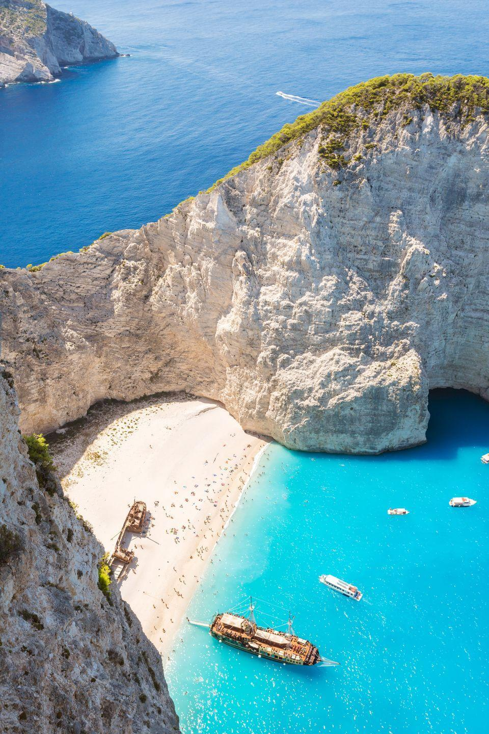 <p>Located in a remote cove on Zakynthos in Greece's Ionian Islands, Navagio Beach gets its nickname—Shipwreck Beach—because of the ship that ran aground here in the 1980's.</p>