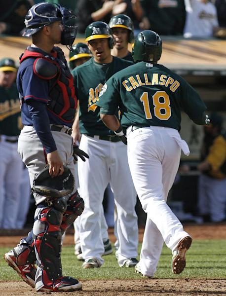 Oakland Athletics' Alberto Callaspo (18) is greeted my teammates after hitting a two-run homer run against the Minnesota Twins during the second inning of a baseball game, Saturday, Sept. 21, 2013, in Oakland, Calif. At left is Twins catcher Josmil Pinto. (AP Photo/George Nikitin)