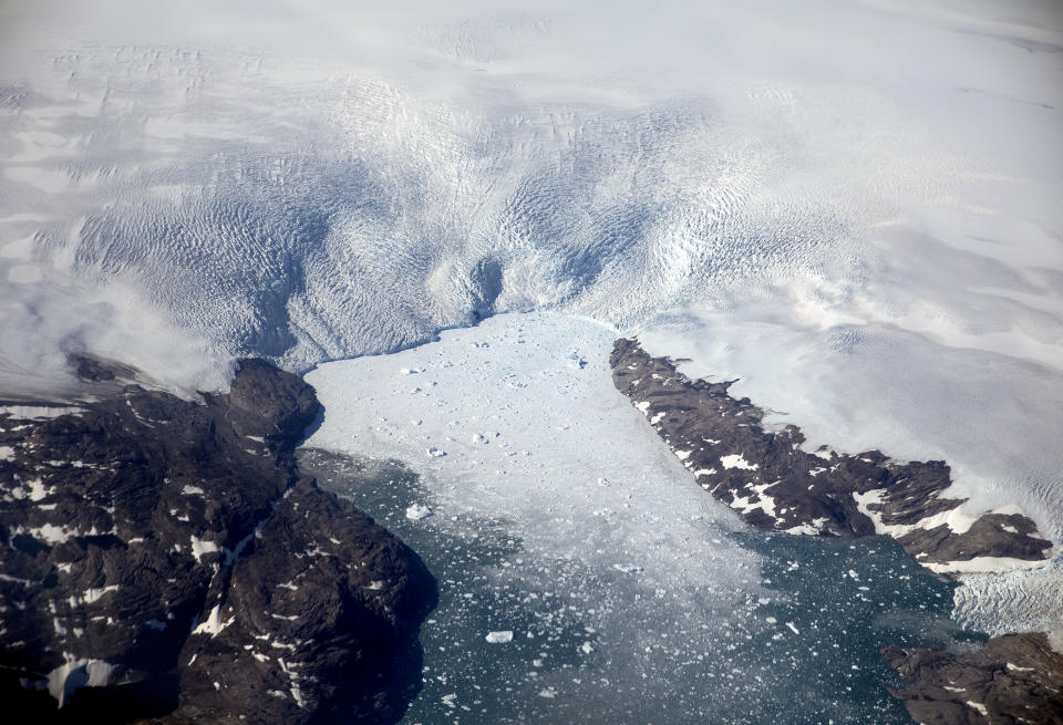FILE - In this Aug. 3, 2017, file photo a glacier calves icebergs into a fjord off the Greenland ice sheet in southeastern Greenland. The Biden administration is stepping up its work to figure about what to do about the thawing Arctic, which is warming three times faster than the rest of the world. The White House said Friday, Sept. 24, 2021, that it is reactivating the Arctic Executive Steering Committee, which coordinates domestic regulations and works with other Arctic nations. It also is adding six new members to the U.S. Arctic Research Commission, including two indigenous Alaskans. (AP Photo/David Goldman, File)