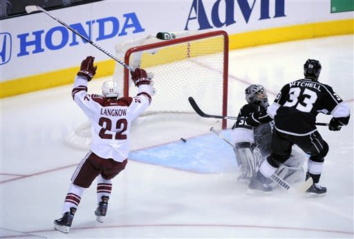 Phoenix Coyotes center Daymond Langkow, left, celebrates his goal as Los Angeles Kings goalie Jonathan Quick, center, and defenseman Willie Mitchell look on during the second period of Game 3 of the NHL hockey Stanley Cup Western Conference finals, Thursday, May 17, 2012, in Los Angeles. (AP Photo/Mark J. Terrill)