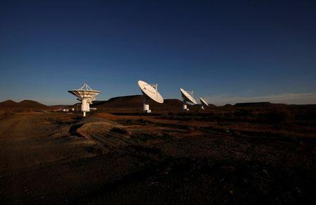 FILE PHOTO: Dusk falls over radio telescope dishes of the KAT-7 Array at the proposed South African site for the Square Kilometre Array (SKA) telescope near Carnavon in the country's remote Northern Cape province, South Africa, May 17, 2012. REUTERS/Mike Hutchings/File Photo