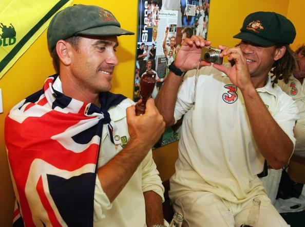 PERTH, AUSTRALIA - DECEMBER 18: Justin Langer (L) of Australia poses with a replica Ashes Urn as team mate Andrew Symonds takes a photo in the changing rooms after day five of the third Ashes Test Match between Australia and England at the WACA on December 18, 2006 in Perth, Australia. (Photo by Hamish Blair/Getty Images)