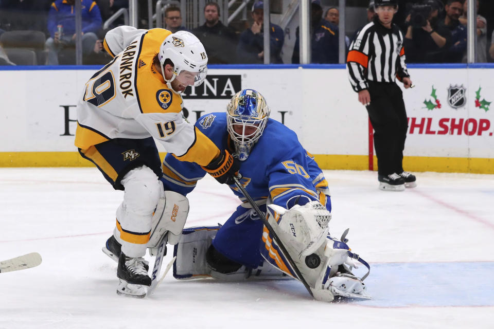 St. Louis Blues' goalie Jordan Binnington (50) makes a save against Nashville Predators' Calle Jarnkrok (19), of Sweden, during the third period of an NHL hockey game Saturday, Nov. 23, 2019, in St. Louis. (AP Photo/Dilip Vishwanat)