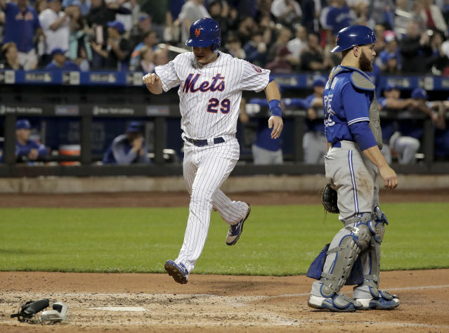 New York Mets' Devin Mesoraco (29) scores on a double by Amed Rosario against the Toronto Blue Jays during the fourth inning of a baseball game, Tuesday, May 15, 2018, in New York. (AP Photo/Julie Jacobson)