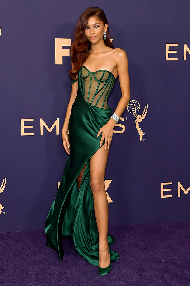 """<p>If you haven't already noticed, Zendaya's red carpet outfits tend to send the internet into something of a tizzy, and her <a href=""""https://www.cosmopolitan.com/uk/fashion/celebrity/g29185344/emmys-2019-best-dressed/"""" rel=""""nofollow noopener"""" target=""""_blank"""" data-ylk=""""slk:2019 Emmys"""" class=""""link rapid-noclick-resp"""">2019 Emmys</a> semi-sheer Vera Wang gown was another case in point. Check out the best Twitter reactions to that leg split <a href=""""https://www.cosmopolitan.com/uk/fashion/celebrity/a29183636/zendaya-emmys-twitter-reactions/"""" rel=""""nofollow noopener"""" target=""""_blank"""" data-ylk=""""slk:here"""" class=""""link rapid-noclick-resp"""">here</a>. </p>"""